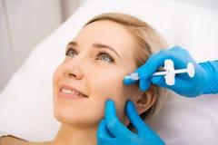 Beauty facial injections. Beautiful women gets beauty facial injections. Face aging injection. Aesthetic Cosmetology Stock Image