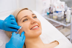 Beauty facial injections. Beautiful women gets beauty facial injections. Face aging injection. Aesthetic Cosmetology Stock Photography