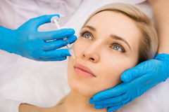 Beauty facial injections. Beautiful women gets beauty facial injections. Face aging injection. Aesthetic Cosmetology Stock Images