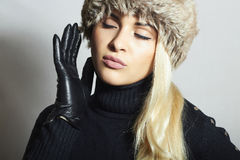 Beauty Fashion blond Girl in Fur Hat. Leather Gloves Royalty Free Stock Photos