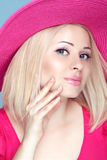 Beauty fashion blond woman in pink hat with makeup and manicured Royalty Free Stock Image