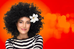 Beauty Fashion Brunette Girl with Flower in Curly Afro Hairstyle Royalty Free Stock Images