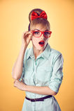 Beauty fashion business woman, red glasses. Pinup Royalty Free Stock Image