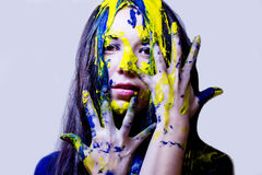 Beauty/fashion close up portrait of woman painted blue and yellow on white background Stock Photos