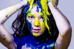 Beauty/fashion close up portrait of woman painted blue and yellow on white background Stock Images