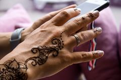 henna tattoo on women hands. Mehndi is traditional Indian decorative art. Close-up, overhead view - beauty and fashion concept royalty free stock images