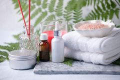 Beauty and fashion concept with spa set on marble plate, sea salt, aroma oil, aroma stick, cotton towels, eco friendly,. Zero waste relax and wellness royalty free stock photos