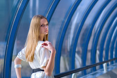 Beauty fashion girl. With blond hair in the hall stock photography