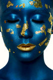 Beauty fashion Girl with closed Eyes, blue Paint on Skin Royalty Free Stock Photo