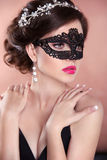 Beauty fashion girl model with mask. Makeup. Hairstyle. Jewelry. Royalty Free Stock Photo