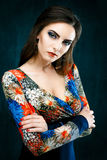 Beauty fashion girl. Portrait of beautiful young woman with red lips dressed in a bright blouse Stock Photos