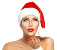 Beauty Fashion Girl with Santa Hat Sending a Kiss Stock Photos