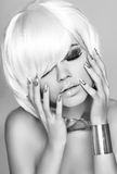 Beauty fashion glam girl portrait. Blond woman with white short hair. Stock Photos