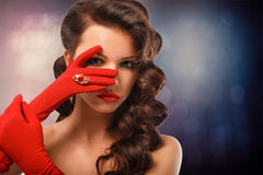 Beauty Fashion Glamorous Model Girl Portrait. Vintage Style Mysterious Woman Wearing Red Glamour Gloves. Jewellery. Jewelry. Holiday Hairstyle and Make-up Royalty Free Stock Image