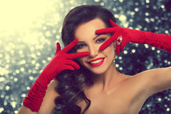 Beauty Fashion Glamorous Model Girl Portrait. Vintage Style Mysterious Woman Wearing Red Glamour Gloves. Jewellery. Jewelry. Holiday Hairstyle and Make-up Royalty Free Stock Photo