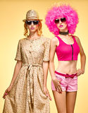 Fashion beauty people, hipster woman, sisters friends, afro. Fashion beauty people. Sexy hipster woman in stylish clothes, sisters, friends. Unusual party look Royalty Free Stock Image