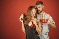 Beauty Fashion model girl. Fashion look. family of man and woman with cup and alarm clock. Stock Images