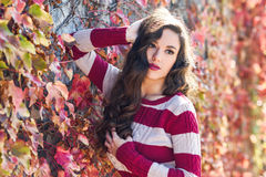 Beauty Fashion Model Girl with Autumnal Make up. Autumn Woman Portrait. Beauty Fashion Model Girl with Autumnal Make up and Hair style. Fall Stock Image