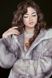 Beauty Fashion Model Girl in Blue Mink Fur Coat. Beautiful Luxur Royalty Free Stock Photography
