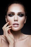 Beauty fashion model girl with bright makeup Stock Photos