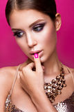 Beauty fashion model girl with bright makeup, long Stock Photos