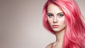 Beauty fashion model girl with colorful dyed hair. Girl with Perfect Makeup and Hairstyle. Model with Perfect Healthy Dyed Hair stock image
