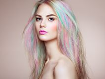 Beauty fashion model girl with colorful dyed hair. Girl with perfect Makeup and Hairstyle. Model with perfect Healthy Dyed Hair. Rainbow Hairstyles Royalty Free Stock Images