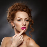Beauty Fashion Model Girl with Curly Red Hair, Long Eyelashes. Royalty Free Stock Photos