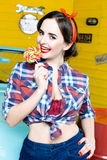 Beauty fashion model girl Eating colourful lollipop. Lollypop. Royalty Free Stock Photography