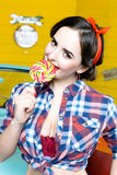 Beauty fashion model girl Eating colourful lollipop. Lollypop. Stock Photos