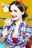 Beauty fashion model girl Eating colourful lollipop. Lollypop. Royalty Free Stock Photos