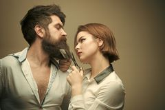 Beauty Fashion model girl. Fashion look. Woman hairdresser cuts beard with scissors. Man with long beard, mustache and Royalty Free Stock Images