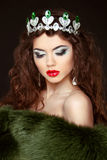 Beauty Fashion Model Girl in Fur Coat. Diamond jewelry. Beautifu Royalty Free Stock Photos