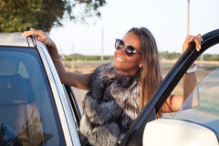 Beauty Fashion Model Girl in fur coat. Royalty Free Stock Photography