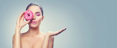 Beauty Fashion Model Girl Holding Sweet Pink Donut Stock Photography