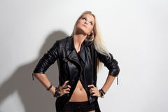 Beauty Fashion Model Girl in Leather Jacket and Shorts. Beauty Fashion Model Girl in Black Leather Jacket and Shorts. Jewelry and Beauty. In studio Stock Photos