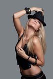 Beauty Fashion Model Girl in Leather Vest and Shorts with a Hat. Stock Images