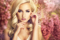 Beauty fashion model. Girl with lilac flowers Royalty Free Stock Photo