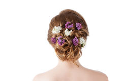 Beauty fashion model Girl with Lilac Flowers Hairstyle. Girl standing back. Royalty Free Stock Photos