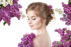Beauty fashion model Girl with Lilac Flowers Hairstyle Stock Photo