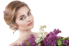 Beauty fashion model Girl with Lilac Flowers Hairstyle. Stock Images