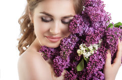 Beauty fashion model Girl with Lilac Flowers Hairstyle. Stock Photography