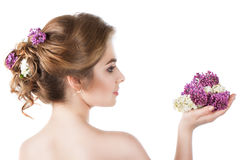 Beauty fashion model Girl with Lilac Flowers Hairstyle. Stock Photo