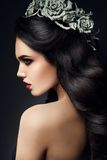 Beauty Fashion Model Girl Portrait with Grey Roses. Hairstyle. Red Lips. Beautiful Luxury Makeup and Hair royalty free stock photography