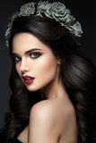 Beauty Fashion Model Girl Portrait with Grey Roses Stock Image