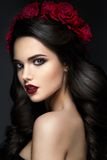 Beauty Fashion Model Girl Portrait with Roses. Beauty Fashion Model Girl Portrait with Red Roses Hairstyle. Red Lips. Beautiful Luxury Makeup and Hair Royalty Free Stock Image