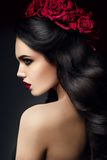 Beauty Fashion Model Girl Portrait with Roses. Beauty Fashion Model Girl Portrait with Red Roses Hairstyle. Red Lips. Beautiful Luxury Makeup and Hair royalty free stock photo