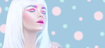 Beauty fashion model girl portrait with white hair, pink eyeliner, gradient lips. Futuristic makeup in white, blue and pink co stock photo