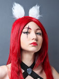 Beauty Fashion Model Girl with red wig on gray background. Royalty Free Stock Photo