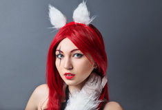 Beauty Fashion Model Girl with red wig on gray background. Stock Photo
